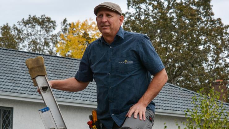 Duncan Atkinson atop a ladder